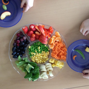 choosing-from-a-rainbow-platter-of-fruit-veg